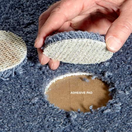 <b>Stick in the patch</b></br> Lay in an adhesive-backed pad to secure the carpet patch. Make sure the nap direction of the patch matches the nap of the surrounding carpet.