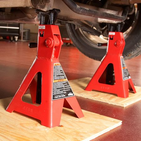 <b>Forget the blocks—use jack stands</b></br> <p>Slip a piece of plywood under the stand to prevent   it from sinking into asphalt or leaving rust stains on   your garage floor. Then slide the jack stands into   place and lower the vehicle. </p>