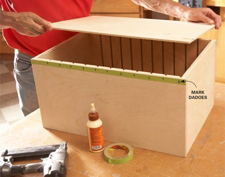 <b>Photo 3: Assemble the box</b></br> <p>Glue and nail the box together with 1-1/2-in. brads.  Then mark the   dadoes to avoid misses when you nail on the back with  1-in. brads.   Glue the perimeter, then nail one edge flush with the  box side.   Square up the box with the back to nail the second  side. Then finish   nailing the remaining two sides. </p>