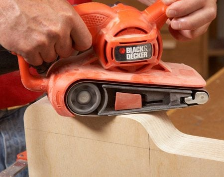 <b>Photo 5: Gang-sand the tray bottoms</b></br> Clamp the tray bottoms together and sand the fronts of them all at once. Get them roughed out and then finish up with a random orbital sander. (If you have a dedicated drum sander or drum sander accessory for your drill press, use that for the inside curves.)