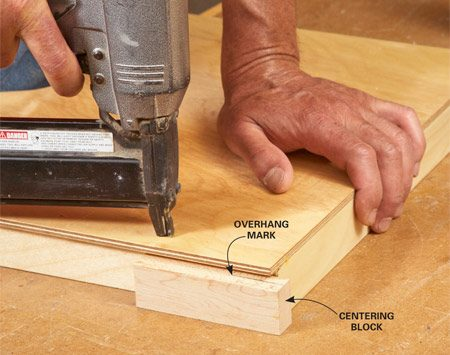 <b>Photo 6: Build the trays</b></br> <p>Glue and nail the tray sides together. Center one of  the bottoms   with equal overhangs, then mark a centering block to  guide you   while you glue and nail on the bottoms. You'll need to  use the   block on just one side for each  tray. </p>