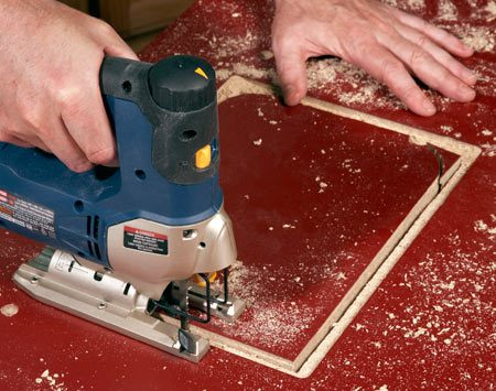 <b>Photo 3: Cut out the plate opening, leaving a lip</b><br/>Drill a starter hole for the blade and cut along the inside of the groove with a jigsaw. That will leave a perfect lip to support the plate.