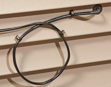 <b>Loop the cable</b></br> <p>A loop provides extra   length for minor repairs   or rerouting later. It also   forces water to drip off   the cable rather than   follow the cable into   the wall. A bushing   seals around the cable   and protects it from   the sharp edges of the   siding. Fasten the cable with clamps.</p>