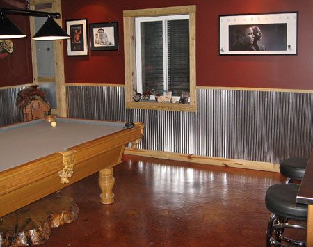 <b>Sports bar</b></br> Brian Gartrell's basement is part pool hall, part sports bar and part Muhammad Ali shrine. Brian met Ali a few times through a mutual friend, and the walls are decorated with cards, photos, even a pair of autographed boxing trunks from the all-time greatest boxer.