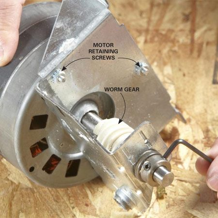 <b>Photo 4: Remove the worm gear</b></br> Loosen the collar setscrews with a hex wrench and slide the worm gear off the shaft. Then remove the motor retaining screws.