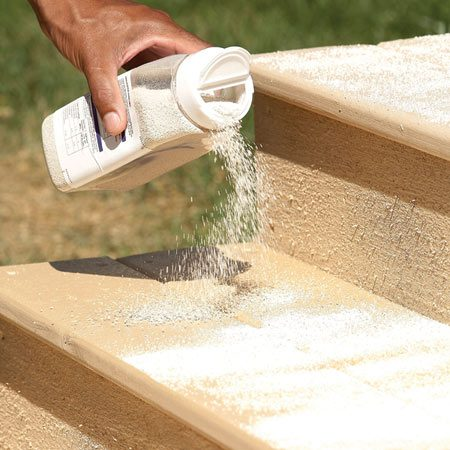 <b>Sprinkle the grit on wet paint</b></br> Apply a fresh coat of paint to the steps. Then immediately sprinkle a generous coating of rubber grit to the surface. Allow it to dry. Then add a second coat to seal the grit.