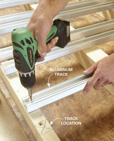 <b>Photo 5: Attach the tracks to the shelf frame</b></br> To avoid working overhead later, screw the tracks to the shelf before you install it. Use the dimensions in Figure B to lay out the track locations.