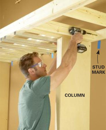 <b>Photo 6: Set the frame on the columns</b></br> Align the ends of the shelf with the outside edges of the columns and screw it to the studs.