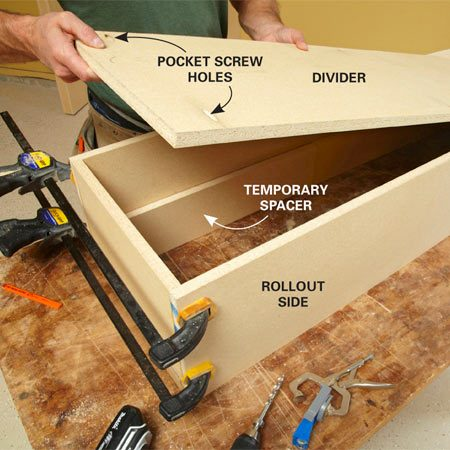 <b>Photo 9: Install the rollout divider</b></br> Use spacers to support the divider while you screw or nail it to the sides of the shelf. Vary the size of the spacers to create different-width shelves.