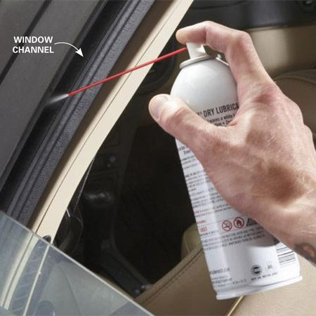<b>Photo 1: Lube window channels</b></br> Lower the window glass and shoot dry Teflon spray down the front, rear and top window channels on each door. Soak the channels. Then run the window up and down several times to spread the lube. Finally, raise the window and clean off overspray with glass cleaner.