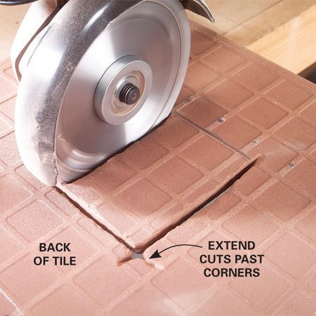 <b>Cut outlet holes</b></br> Outline the light switch or outlet box on the face of the tile. Cut as much as you can, then finish the cut from the back, where you can overcut the corners slightly.