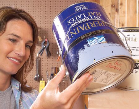 <b>Store cans upside down</b></br> Store paint cans upside down and the paint will form an airtight seal around the rim. Make sure the cover is on tight to prevent leakage. Hold the can upright and shake it vigorously before you open it so the solids in the paint drop off the lid.