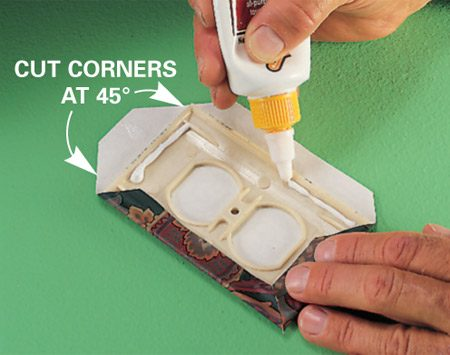 <b>Photo 2: Cover switch plate and glue in place</b></br> Wet or apply paste to the paper, position it and gently remove the wallpaper and plastic cover from the wall. Next, fold the edges back around the cover and secure them with wall covering seam repair (Photo 2). Cut the corners for crisper folds.