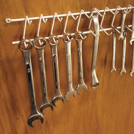 <b>Hang wrenches on a tie/belt rack</b></br> Are all your wrenches stuffed in a plastic bucket? Here's a better idea. Screw a tie/belt rack (available at discount stores) to a bare spot on the wall over your workbench and hang the wrenches—SAE and metric—where you can swiftly nab and put them away in an orderly fashion.