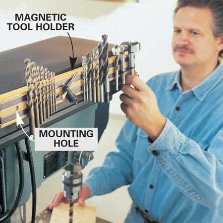 <b>Mount a magnetic tool holder for bits</b></br> <p>Mount an 18-in.  Magnetic Tool Holder (No. 81281) to your drill press's pulley   cowl for  quick-change bit storage (available at rockler.com). The tool holder is inlaid  with powerful magnetic strips   that tightly hold  all sizes of bits, plus it's easy to mount. Mark and drill a couple   of 1/4-in. holes  through the cowl   of your drill press.  Then use two   1-1/4 in. x  1/8-in.-diameter bolts   with nuts and  washers to attach   the holder.</p> <p>While you're  ordering, buy a   few extra magnetic  tool holders   and use them  elsewhere in your   shop to hold  chisels, squares,   router bits, metal  rulers, wrenches   and all those  easy-to-misplace   accessories. </p>