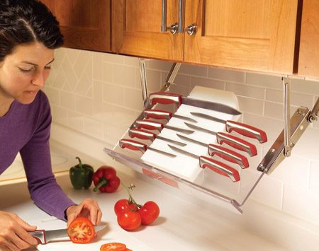 <b>Install under-cabinet storage racks</b></br> <p>Pull-down racks give you  instant access to kitchen essentials   without the clutter of  spice racks or knife holders. When the   cooking is done, the rack  swings up against the underside of the   cabinet. You can buy  ready-made racks or buy a pair of hinges and   make your own wooden rack  to hold knives, spices or other small   items that take up counter  space. You'll find a variety of racks    and hardware at <a href='http://www.ikea.com'>ikea.com</a>, <a href='http://www.wwhardware.com'>wwhardware.com</a>  and other online retailers.</p>