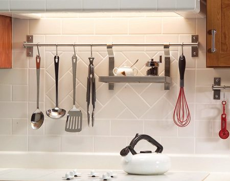 """<b>Take advantage of unused storage space</b></br> <p>Backsplash racks offer  easy access and   stylish storage. Most  versions take just a   few minutes to install.  Type """"backsplash   rack"""" into any online  search engine to   find a range of styles.  You'll also find a   range of prices (up to $60  per foot!). The   stainless steel rails  shown here cost   about $3 per foot, and  add-on shelves   and bins range from $6 to  $20 plus   shipping at <a href='http://www.ikea.com'>ikea.com</a>. </p>"""