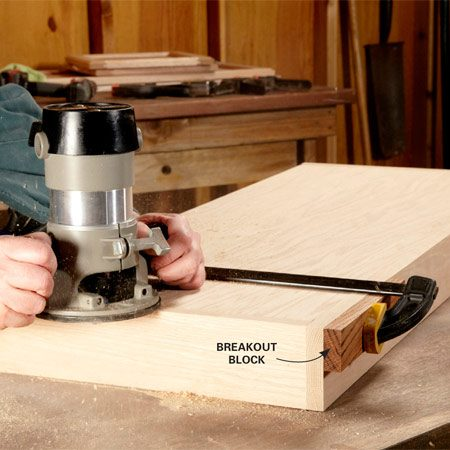 <b>Photo 2: Build the base</b></br> Rout a decorative cove after the base is assembled. That gives you perfect corners without fussy miter cuts. To avoid splintering at the corner, clamp on a breakout block.