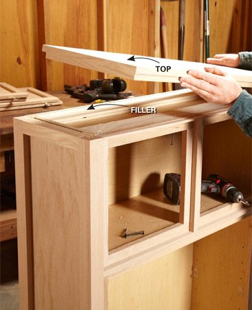 <b>Photo 3: Top it off</b></br> Glue the two layers of the top together. To attach the top, drive screws from inside the cabinet, through the fillers and into the top.