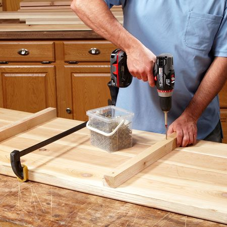 <b>Photo 2: Construct the box sides</b></br> Straighten bowed boards with a clamp. The top boards need to be straight so the cap will go on straight and tight.