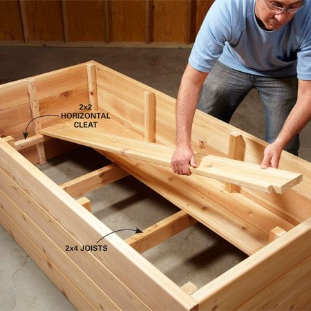 <b>Photo 5: Attach the joists and lay the floor</b></br> Screw the horizontal end cleats in place first and then the center joists. Notch your deck boards to fit around the vertical supports.