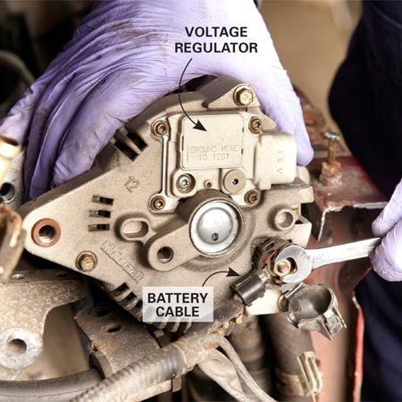 """<b>Photo 2: Disconnect the cables from the alternator</b></br> <p>Depress the latch clip on the  electrical    connector going to the voltage  regulator    and wiggle it out. Then loosen  the locknut    to the """"BAT"""" cable and remove  the ring    terminal. </p>"""