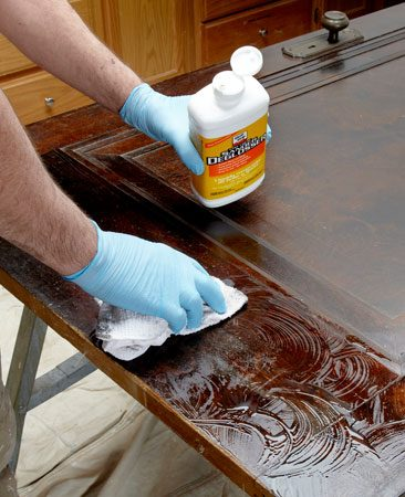 <b>Try liquid sander/deglosser</b><br/><p>Every surface should be  cleaned before it&rsquo;s painted, but    painting over clear finishes  like varnish or polyurethane    requires extra care to ensure  that the new paint bonds    well. Thorough sanding is one  way to prepare the surface.    But a liquid sander/deglosser  is easier and faster.    Jay uses Klean-Strip Easy  Liquid Sander Deglosser, but other types are available.</p> <p>Read the instructions on the  container and follow    them carefully. Some types of  &ldquo;liquid sandpaper&rdquo;    require you to paint over them  before they dry. Others,    like the one Jay is using,  should dry first. Follow the    sander/deglosser with a coat  of bonding primer. Ask for    it at the paint department.  Most major paint manufacturers    sell it. Valspar Bonding  Primer is one example.</p>