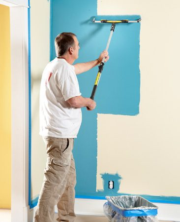 <b>Painting tip for big spaces</b></br> <p>An 18-in.-wide roller    setup like this may not    be for everybody.    Painters use them for    the obvious reason that    they can paint twice as    fast as they can with a    standard 9-in. roller.</p> <p>If you have a lot of    large, unbroken walls    and ceilings, the investment    in a large paint    pail, 18-in. roller    cage and 18-in.    cover makes    sense for you, too. You'll    definitely save a bunch    of time. Plus, because    the roller is supported    on both edges instead    of just one, it's easier to    apply consistent pressure    and avoid roller    marks left by paint    buildup at the edge of    the roller.</p> <p>You'll find 18-in. roller    equipment at most    home centers and paint    stores. </p>