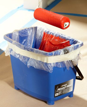 <b>Photo 1: Line the pail to simplify cleanup</b></br> <p>Use thin painter's plastic to  line the    pail. Cut a piece of plastic  and drape    it into the pail. Add your  paint and    then run a band of masking  tape    around the perimeter to hold  the    plastic  in place. </p>