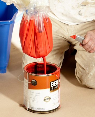 <b>Photo 2: Drain the leftover paint back into the can</b></br> <p>When you're done painting,  just    bundle up the plastic and pull  it out. If    there's leftover paint, hold  the plastic    over your paint can and slit  the    bottom with a utility knife to  drain the    paint  back into your paint can. </p>