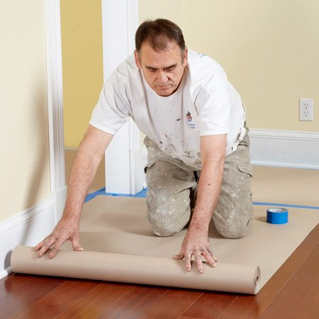 <b>Better floor protection</b></br> <p>Drop cloths can be a hassle.  They slip on    hard floors, get bunched up  under ladders    and are difficult to fit tight  to baseboards.    Eliminate the hassle and save  time by using    rosin paper instead. For about  $12, you can    buy a 160-ft.-long roll of  3-ft.-wide heavy    masking paper. Roll it out,  leaving about a    1/2-in. space along the wall  for the tape.    Then cover the edges with tape  to keep it in    place. You'll find rolls of  masking or rosin    paper  at home centers and paint stores. </p>