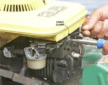 "<b>Photo 2: Reinstall the cable and adjust the choke</b></br> Remove the air cleaner assembly so you can see the choke plate. With the throttle control lever in the ""choke"" position, pull on the outer jacket of the cable near the clamp until the choke plate opens. Tighten the clamp with the cable in this position. Reassemble the air cleaner."