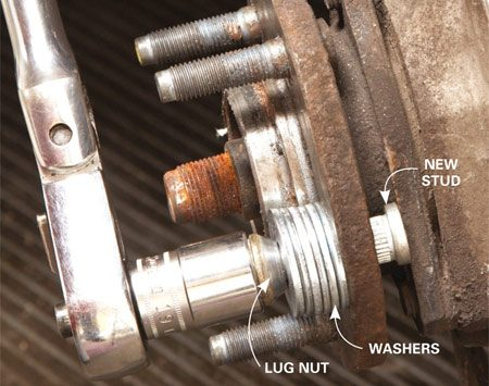 <b>Photo 2: Pull in the new wheel stud</b></br> Stop tightening when the head of the wheel stud sits flush with the back of the hub. Install the second lug nut (the one you didn't toss) on the new stud—it'll go on easier. Tighten with a torque wrench.