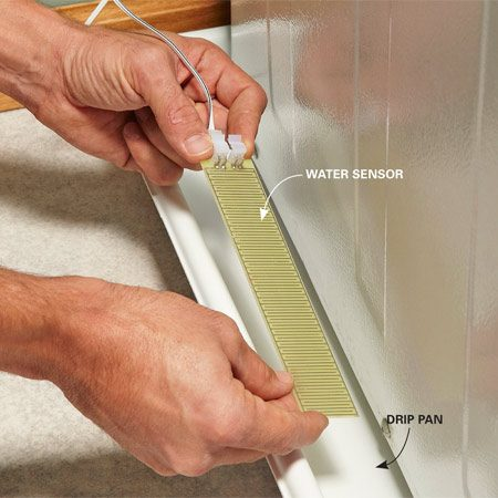 <b>Photo 3: Place the floor sensor</b></br> Slide the floor sensor into the washing machine drain pan (if you have one) or lay it on the floor below the washing machine.