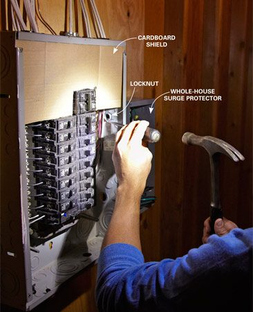 """<b>Photo 1: Secure the offset nipple to the main panel</b></br> <p>Remove a  knockout on the main panel and insert the offset nipple. Spin on   the  dimpled locknut with the locking """"ears"""" facing the wall of the panel. Then   tighten  it with a flat-blade screwdriver and hammer. </p>"""