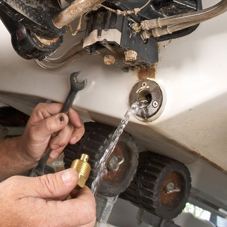 <b>Photo 3: Yank the hull plug</b></br> <p>Remove  the hull plug with an open or box-end wrench. Don't use an adjustable   wrench—it  will round off the shoulders on the brass plug. </p>