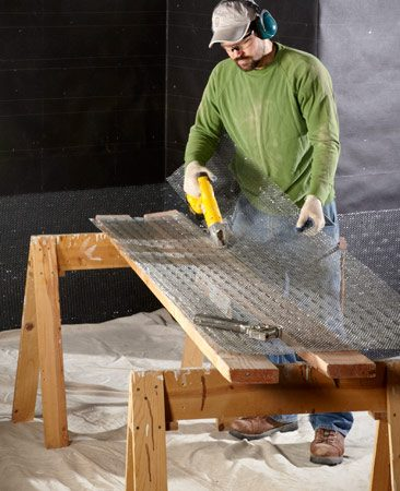 <b>Easy way to cut wire lath</b></br> Make long cuts by stapling wire lath to a long board and cutting along a board edge.