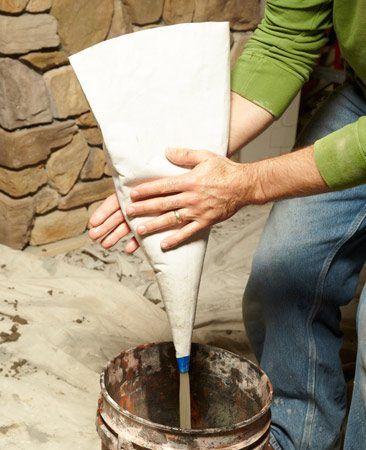 Rinse the grout bag with water to remove sand build-up.