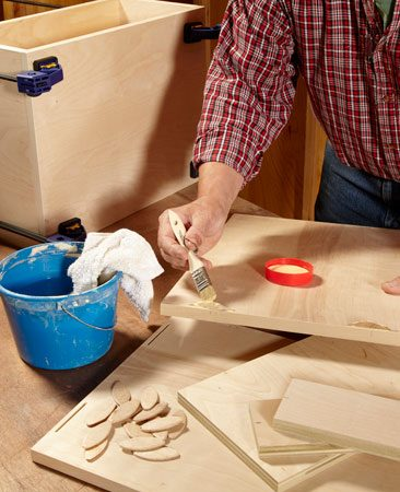 <b>Photo 4: Assemble the boxes</b></br> A cheap disposable paintbrush makes a good spreader. Keep a damp rag handy to wipe off excess glue.