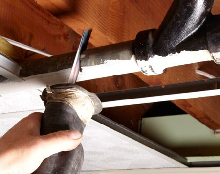 <b>Photo 4: Cut out the old section</b></br> <p>Use a reciprocating  saw and a metal-cutting blade   to cut  out the fittings and the pipe leading to   and from  the cleanout wye or tee. </p>