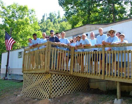 <b>Porch and ramp-building crew</b></br> Celebrating the porch completion with an American flag.