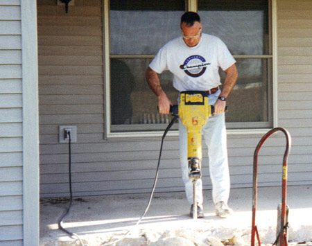 <b>Curt using a jackhammer</b></br> Curt built an office addition on his home.