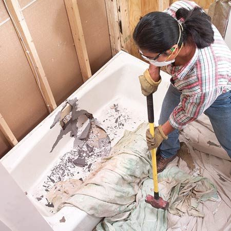 <b>How to get rid of a bathtub</b></br> <p>Some things are just so heavy  to move in one piece   that you shouldn't unless you  absolutely have to. A   cast iron bathtub is one of  them. The trick to getting rid of it is to break   it up with a sledge. But be  careful! Cast iron shrapnel   is sharp and dangerous. Cover  the tub with a   blanket or drop cloth and be  sure to wear long   sleeves, safety glasses and  hearing protection. Don't   expect the tub to break easily  on the first swing. You   may have to hit the same spot  repeatedly to get a   crack started. It's hard work,  but at least you won't   break your back trying to lift  the tub in one piece. This trick works for cast iron radiators and  pipe too.</p>