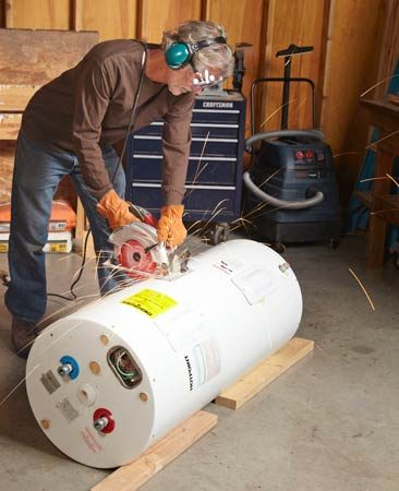 <b>How to get rid of a water heater</b></br> <p>It's a lot easier to move a  water heater in two pieces—especially if it   has 50 lbs. of sediment in the  bottom—and it's surprisingly easy to cut   one in half. You could use a  recip saw, but a circular saw with a ferrousmetal   cutting blade is faster. Be  sure to wear goggles or a face shield,   hearing protection and long  sleeves. Many appliances can be cut; just be careful not to cut through refrigerant tubing  or glass.</p>