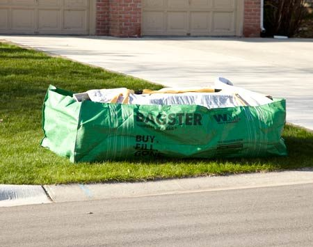 <b>How to get rid of debris</b></br> <p>If you have too much junk to  fit in   your trash can, but not enough  to   warrant renting a 10- or  20-yard   trash container, then a Bagster  bag   is the answer. Buy the green  poly   bag at a home center or  hardware   store, fill it up and call the  company   for a pickup. The bag holds 3  cubic   yards or up to 3,300 lbs. of  debris.   The Bagster bag costs around  $30. When   you're done with it, you'll be   charged a flat rate of $80 to  $160 to   have it picked up, depending  on collection   costs in your area. Find out more at <a href='http://www.thebagster.com' target='_blank' rel='nofollow'>thebagster.com</a>.</p>