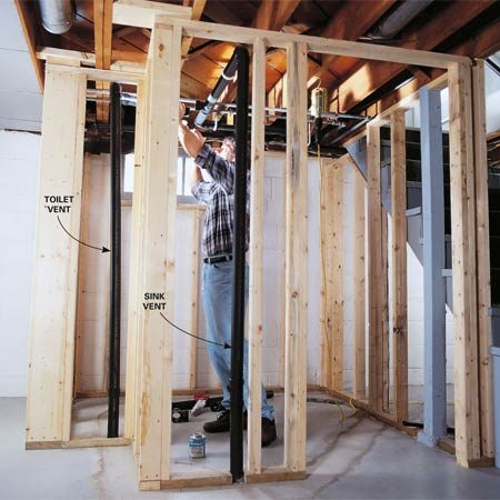 <b>Photo 6: Build the vent system</b></br> After framing the bathroom walls, assemble the vent lines. We ran our vent lines below the floor joists and later framed a lower ceiling to hide the pipes.