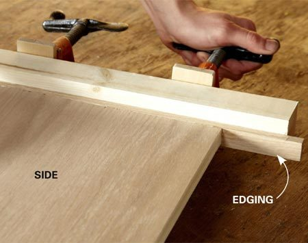 <b>Photo 1: Add edging to the sides</b></br> <p>Cut the plywood box   parts to size, then glue   strips of wood to the   bottom edges of the box   sides. This edging keeps   the plywood veneer from   chipping. Trim off the   excess edging with a   handsaw and sand it   flush with the plywood.   Take care not to sand   through  the thin veneer. </p>