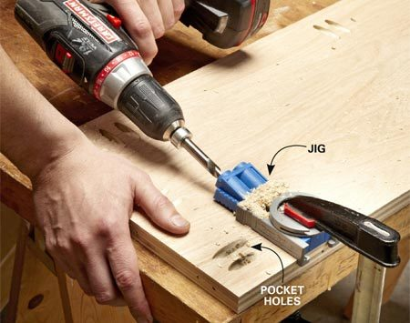<b>Photo 2: Drill pocket holes</b></br> <p>Pocket hole jigs are super   easy to use: Place the jig   where you want the holes;   clamp and drill. The   stepped bit bores a pocket   hole and a pilot hole at the   same time. The holes on   the ends are for attaching   the top to the sides. The   holes along the front and   back are used to attach   the  box to the face frame. </p>