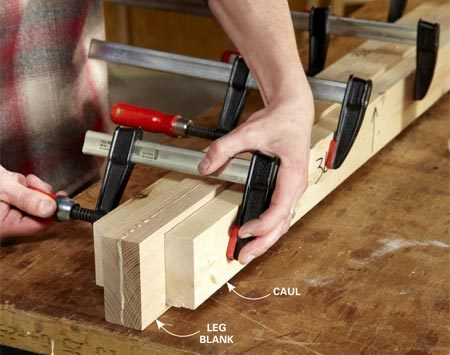 "<b>Photo 4: Glue up the leg blanks</b></br> <p>Sandwich two 1x4s together and  later cut the legs from this stock.   Use  scrap wood ""cauls"" to distribute clamping pressure evenly. </p>"