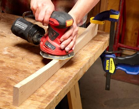 <b>Photo 7: Sand the arches</b></br> Smooth the arches with an orbital sander. Keep the sander moving so you don't sand too deep in one spot and create a wave in the curve.